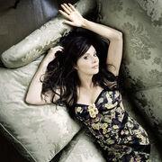 Sarah Brightman lying on the sofa