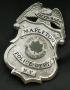 File:MapletonPoliceDepartmentBadge.png