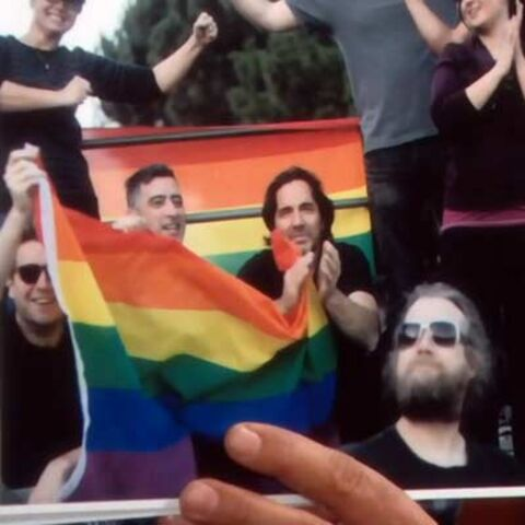 Fabrice and Ridge in the pride parade in Paris.
