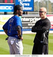 Stock-photo-port-st-lucie-florida-march-ny-mets-shortstop-jose-reyes-l-chats-with-team-physical-49787614