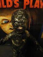 Burned Chucky up on display.