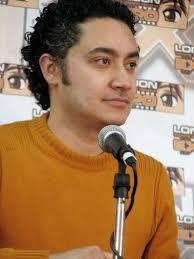 File:Alessandro Juliani Orange Sweater 1.jpg