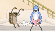 S7E06.024 Rigby Giving Mordecai a Birthday Card