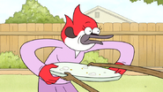 S6E20.102 Rigby Shoving a Plate into Margaret's Stomach