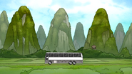 S7E15.044 Bus Driving By the Green Mountains