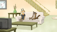 S5E05.060 Rigby Groaning on the Couch