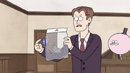 S7E09.124 The Prosecutor Holding a Bag of Wolfhard's Fur