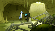 S6E19.155 Mordecai and Rigby Looking at Tim and Mark's Corpses