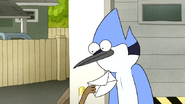S6E06.169 Rigby Rubbing His Paycheck in Mordecai's Face