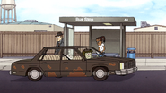 S7E08.147 Muscle Man Passing the Bus Station