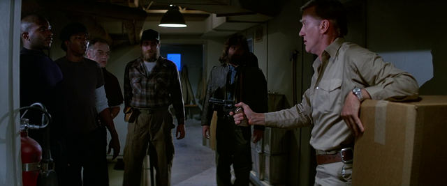 File:Garry assures the men of his innocence - The Thing (1982).png