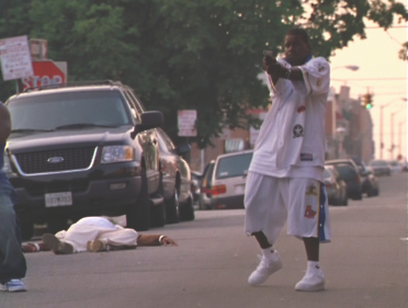 File:WIRE Season 3- Rico shoots at Omar's crew during robbery.jpg