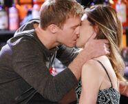 Travis kisses Victoria passionately