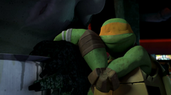 Mikey hanging off Leatherhead's arm