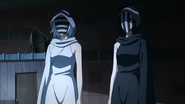Nashiro and Kurona with their masks