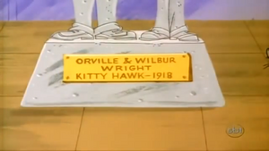Kitty Hawk Kitty - Orville and Wilbur Wright statue