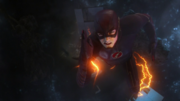 Barry jumps through the wormhole to save Central City