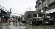 US Navy 091004-M-9443M-134 Members of the U.S. Armed Forces and the Armed Forces of the Philippines deliver family food packs