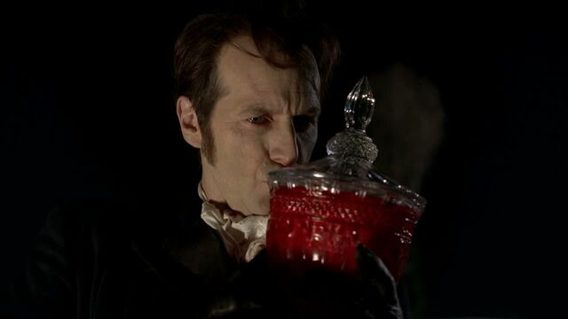 File:3x09 -russell kisses talbot's remains in a jar.jpg