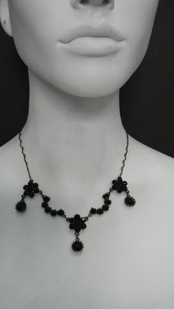 File:Marianna-harutunian-swarovski-crystals-in-hematite-and-hematite-plated-metal-profile.jpg