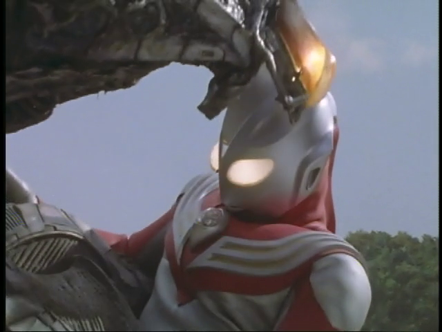 File:Tiga doesn't want a hug.png