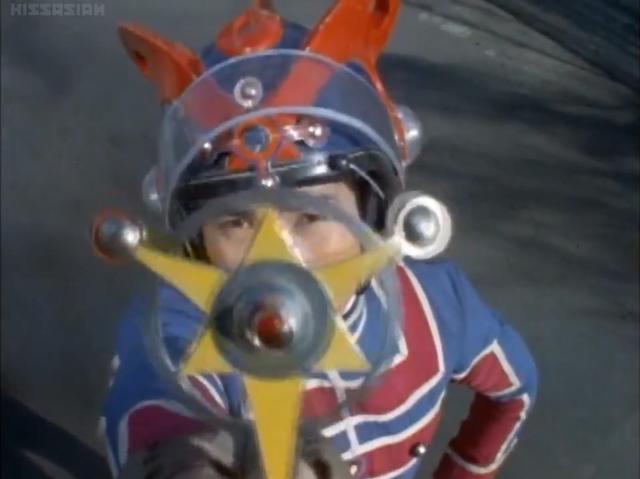 File:Kotaro henshin with Ultra Badge.png