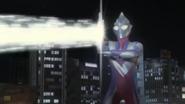 Tiga fires his Zepellion Ray