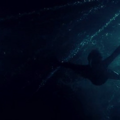 Selene swims to save Michael.