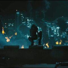 Selene overlooks the destroyed city.