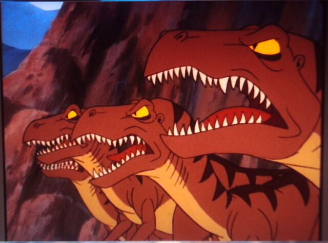 File:4 angry, snarling Velociraptors.JPG