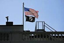 American and POW*MIA flag flying