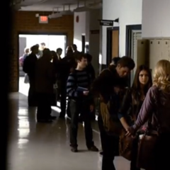 Stefan, Elena, and Caroline talking in front of the lockers in 1x16