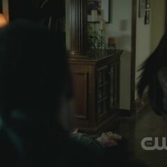 Tony sees Elena run towards Alaric.