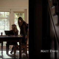 A zoom in of the same shot – the same kitchen door in the back, the table is between the kitchen on the right and living room 2 on the left