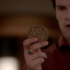 Lucien finds the medallion