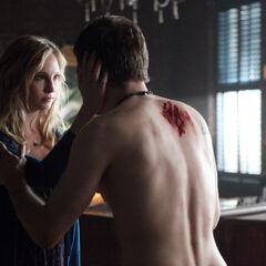 Silas posing as Caroline, talking to Klaus
