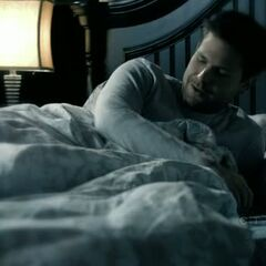 Alaric in bed talking to Isobel