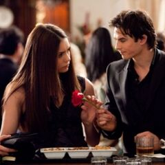 Damon giving Elena a rose.