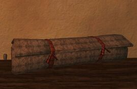 Rolled up strapped firegrass qalian-Rug