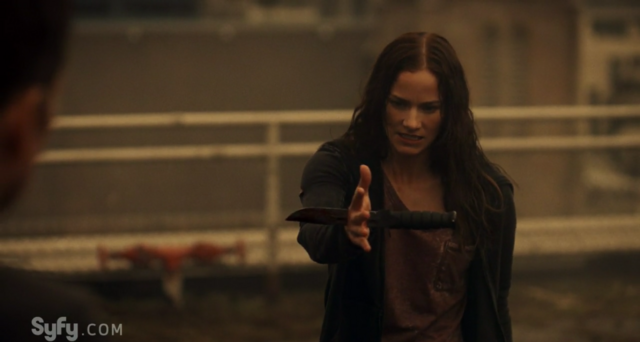 File:Help Me 1x01 Vanessa with a knife stabbed through her hand.png