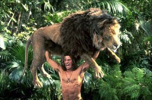 George of the Jungle lifting a Lion