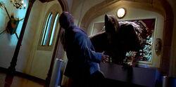 Johnny Bartlett as The Grim Reaper killing somebody.