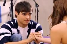 Leon holding Violetta's hand
