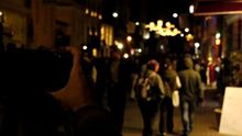 Stock-footage-a-photographer-takes-picture-of-a-crowded-street-at-night
