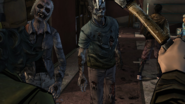 Kenny and Clem confronting walkers