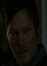 File:Daryl beside the dying fire.png