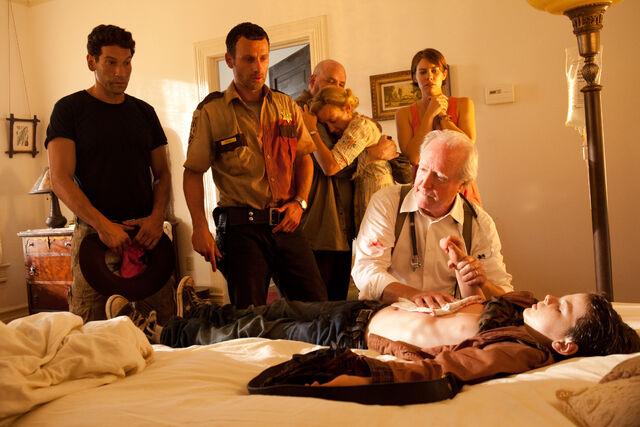 File:Episode-2-group-carl-bed.jpg