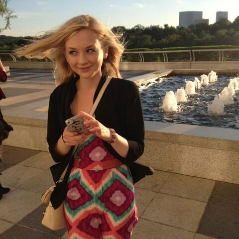 File:Emily Kinney at a beautiful city and waterfall while looking at something.JPG