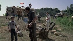 Shane, Carl, DAle and other survivors at camp