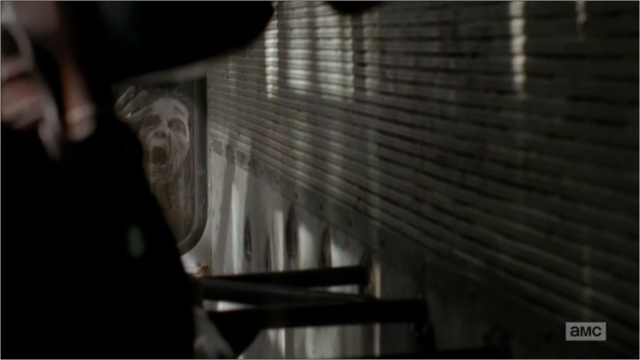 File:5x05 A Walker Outside The Bus.png